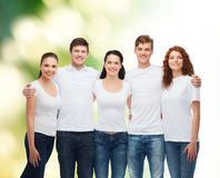 Group of smiling teenagers in white blank t-shirts Stock Photo
