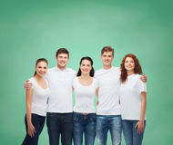 Group of smiling teenagers in white blank t-shirts Royalty Free Stock Image
