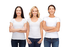Group of smiling women in blank white t-shirts Stock Images