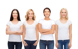 Group of smiling women in blank white t-shirts stock photo