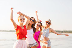 Group of smiling women dancing on beach Royalty Free Stock Photography