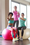 Group of smiling women with exercise balls in gym. Fitness, sport, training and lifestyle concept - group of smiling women with exercise balls in gym Royalty Free Stock Photography