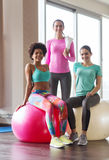 Group of smiling women with exercise balls in gym Royalty Free Stock Image