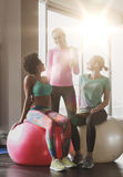Group of smiling women with exercise balls in gym Royalty Free Stock Photos
