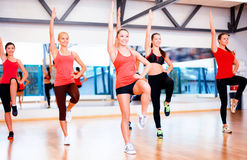 Group of smiling women exercising in the gym Royalty Free Stock Photo