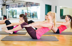 Group of smiling women exercising in the gym Royalty Free Stock Image