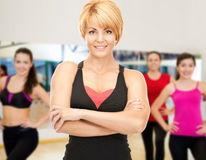 Group of smiling women exercising in the gym Stock Images