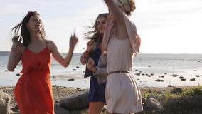 Group of smiling women or girls dancing on beach 32 stock footage