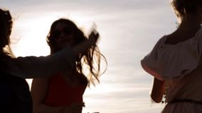 Group of smiling women or girls dancing on beach 18 stock footage