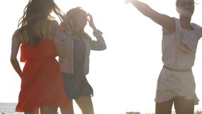 Group of smiling women or girls dancing on beach 14 stock footage