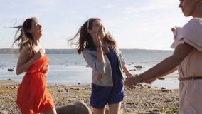 Group of smiling women or girls dancing on beach 69 stock video footage