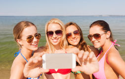 Group of smiling women making selfie on beach Stock Photography
