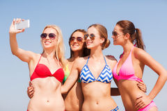 Group of smiling women making selfie on beach Royalty Free Stock Image