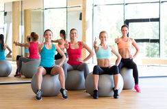 Group of smiling women showing thumbs up in gym Royalty Free Stock Images
