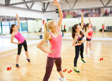 Group of smiling women stretching in the gym Stock Image