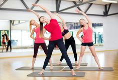 Group of smiling women stretching in the gym Royalty Free Stock Photo