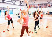 Group of smiling women stretching in the gym Stock Images
