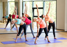 Group of smiling women stretching in gym Stock Image