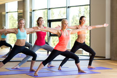 Group of smiling women stretching in gym Royalty Free Stock Images