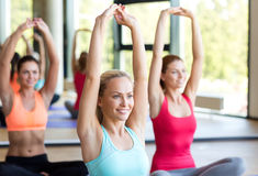 Group of smiling women stretching in gym Royalty Free Stock Photos