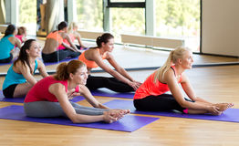 Group of smiling women stretching in gym Royalty Free Stock Photography