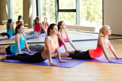 Group of smiling women stretching in gym Royalty Free Stock Photo