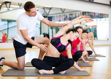 Group of smiling women stretching in the gym Royalty Free Stock Photos