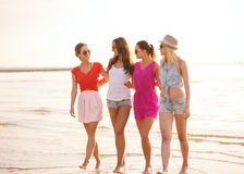 Group of smiling women in sunglasses on beach Stock Image