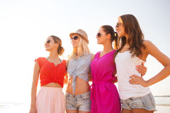 Group of smiling women in sunglasses on beach Royalty Free Stock Photography