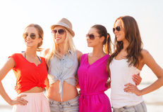 Group of smiling women in sunglasses on beach Royalty Free Stock Photo