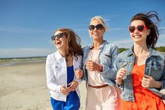 Group of smiling women in sunglasses on beach Stock Photos