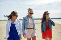 Group of smiling women in sunglasses on beach Royalty Free Stock Photos
