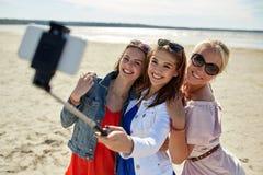 Group of smiling women taking selfie on beach Royalty Free Stock Photo