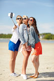 Group of smiling women taking selfie on beach Royalty Free Stock Photography