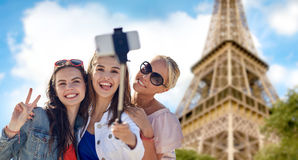 Group of smiling women taking selfie in paris. Summer vacation, holidays, travel, technology and people concept- group of smiling young women taking picture with royalty free stock photos