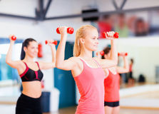 Group of smiling women working out with dumbbells Royalty Free Stock Image