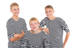Group of smiling yong men in striped shirt. Group of smiling young men in striped shirt isolated on white background. Two of the boys twin brothers stock photo
