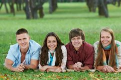 Group of smiling young students outdoors Stock Photos
