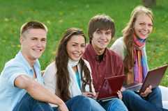 Group of smiling young students outdoors Royalty Free Stock Images