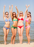 Group of smiling young women on beach Stock Photo