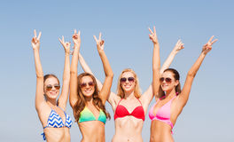 Group of smiling young women on beach Royalty Free Stock Photography