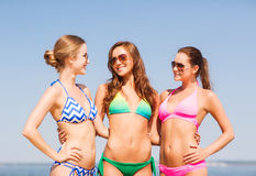 Group of smiling young women on beach Stock Photography