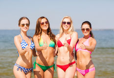 Group of smiling young women on beach Royalty Free Stock Images