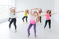 Group of smiling young women with coach at fitness dance class stock photos