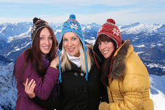 Group of smiling young women people in winter in the mountains Royalty Free Stock Photos