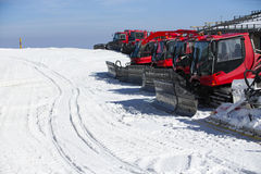Group of Snow-grooming machine on snow Royalty Free Stock Photo