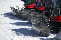 Group of Snow-grooming machine on snow hill Stock Image