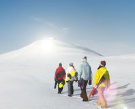 Group of snowboarders enjoying a beautiful Winter morning Concep. T Stock Image