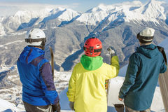 Group of snowboarders and skier at summit Royalty Free Stock Image