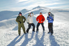 A group of snowboarders. And skiers high in mountains Royalty Free Stock Photo